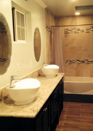 bathroom renovation custom sink, vanity and flooring
